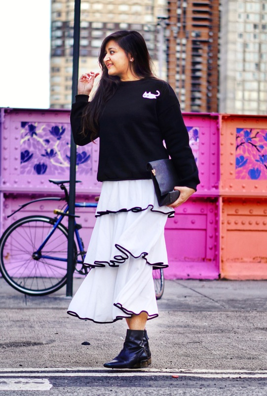 skirt and sweatshirt street style outfit 1