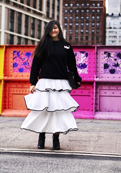 skirt and sweatshirt street style outfit 3