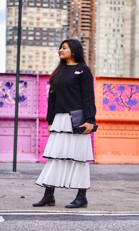 skirt and sweatshirt street style outfit 4